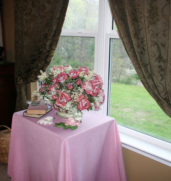 Pink tablecloth on tble in windowIMG_1569