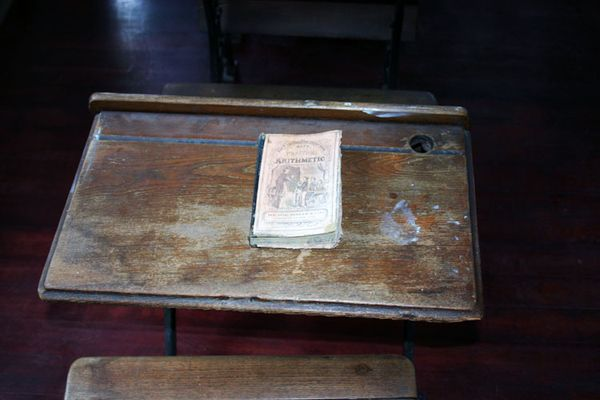 School house desk with math book