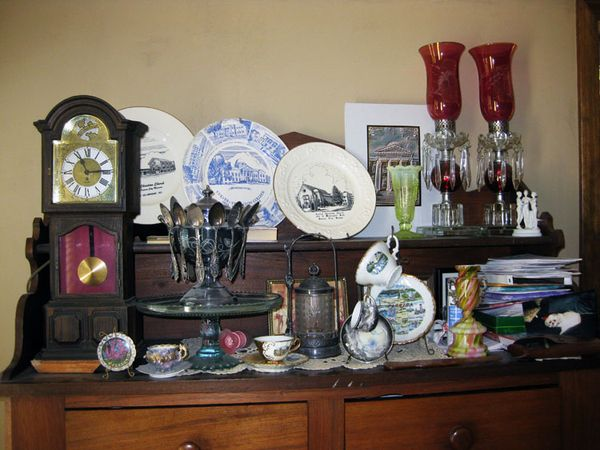 Antiques on an antique cabinet