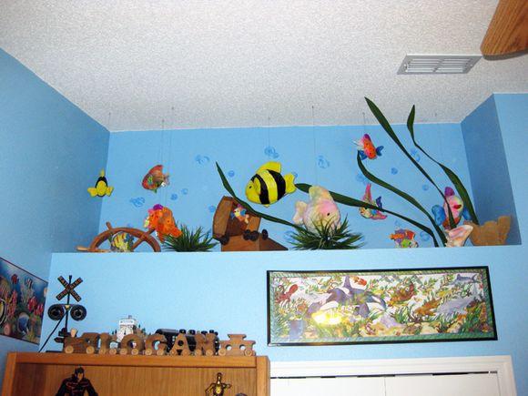 Logans room shelf of fish