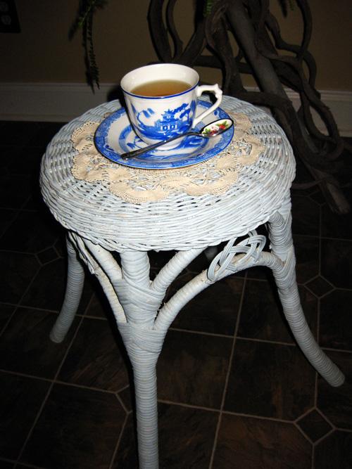 Blue tea cup with tea.