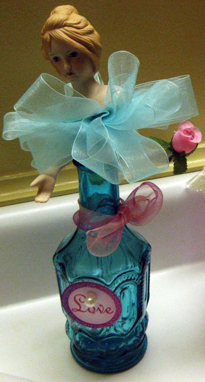 Blue bottle with doll