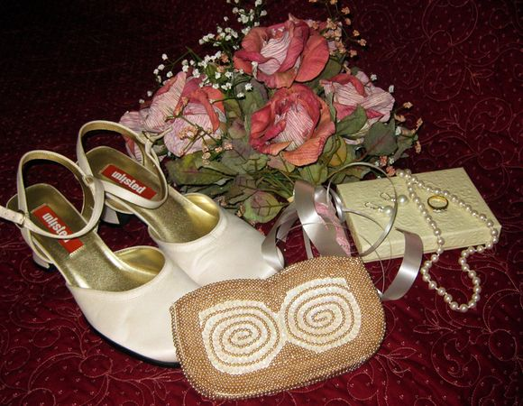 Wedding shoes jewelry flowers