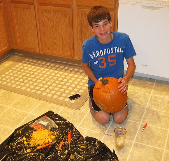 Logan carving pumpkins